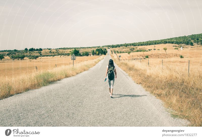 Woman with backpack walking on the road Lifestyle Beautiful Vacation & Travel Trip Summer Human being Girl Adults Cinema Nature Sky Tree Grass Street
