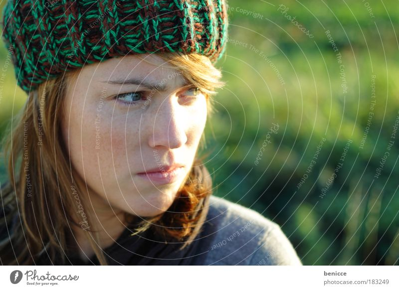 There'll be trouble. Woman Human being Youth (Young adults) Freckles Cap Woolen hat Red-haired Autumn Portrait photograph Close-up Evil Anger Sour Looking away