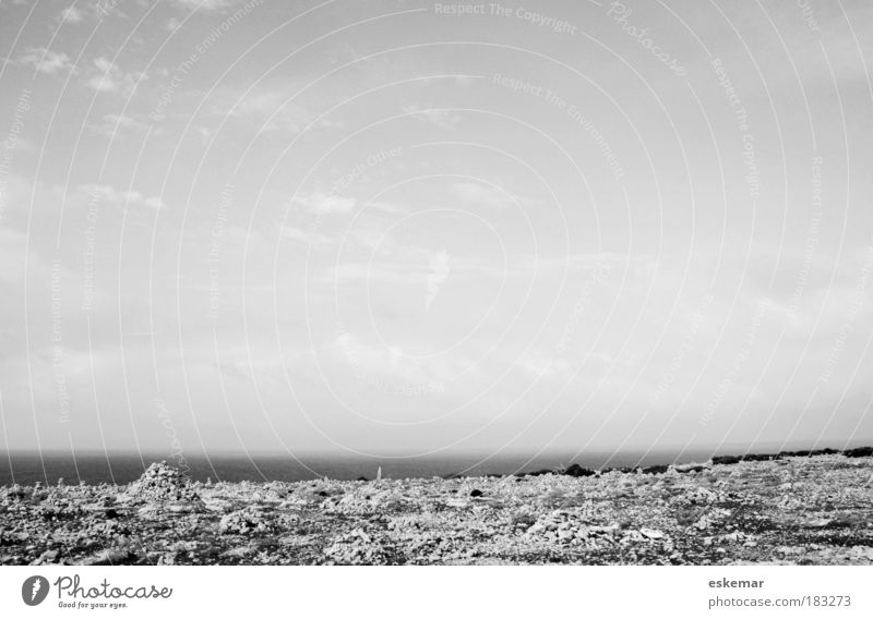 Nature Water Sky Ocean Loneliness Far-off places Dream Stone Sadness Sand Landscape Coast Horizon Rock Earth Island