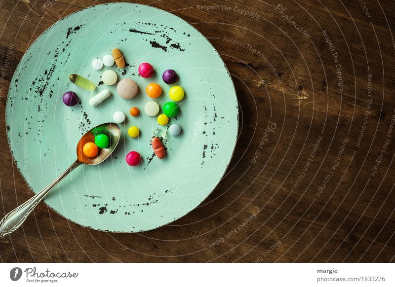 Colourful pills with tea spoon on a plate Nutrition Diet Fasting Plate Spoon pretty Healthy Illness Overweight Doctor Health care Brown Multicoloured Green Red