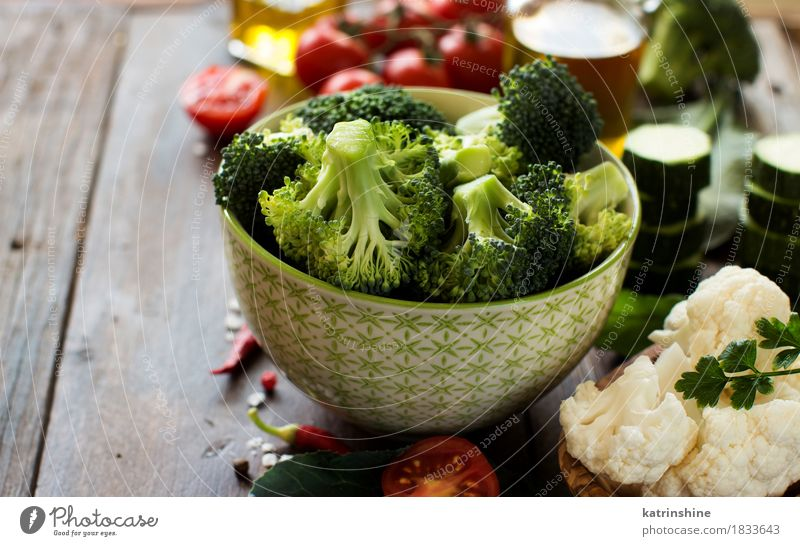 Fresh green broccoli and vegetables Food Vegetable Herbs and spices Cooking oil Nutrition Eating Vegetarian diet Diet Bowl Table Autumn Leaf Dark Healthy