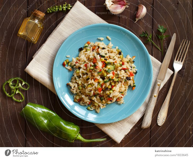 Risotto with vegetables Food Vegetable Grain Herbs and spices Cooking oil Nutrition Lunch Dinner Vegetarian diet Diet Plate Bottle Knives Fork Wood Healthy