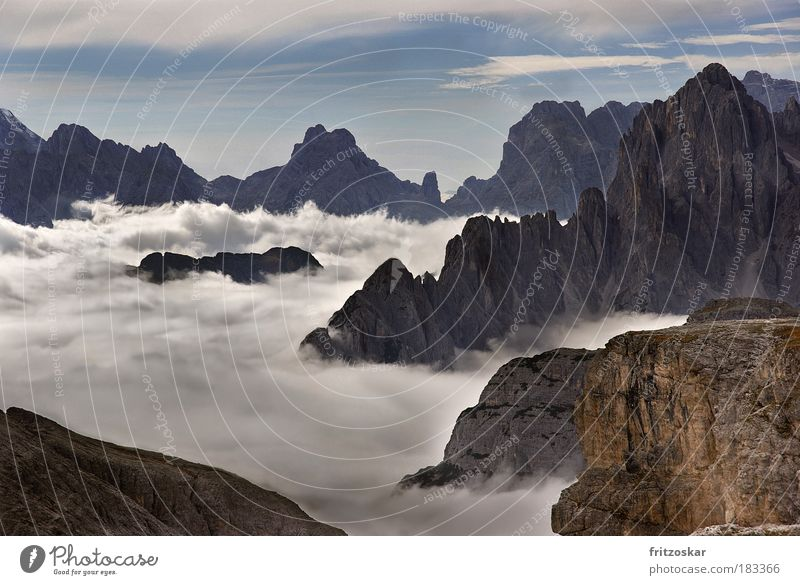 carpet of clouds Colour photo Exterior shot Deserted Contrast Panorama (View) Tourism Far-off places Freedom Mountain Nature Landscape Sky Clouds Fog Rock Alps
