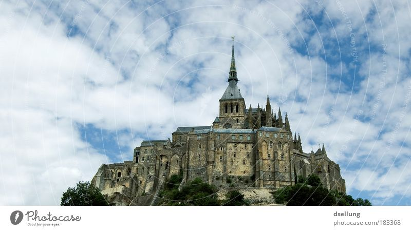 Mont-Saint-Michel in the background blue sky with white light clouds Colour photo Exterior shot Deserted Copy Space left Copy Space top Day Contrast Sunlight
