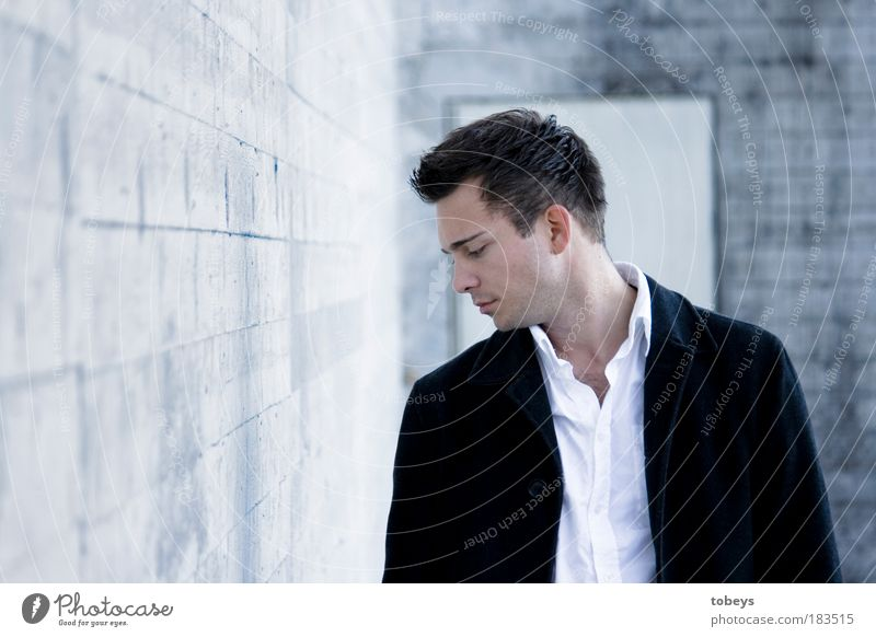 Youth (Young adults) Man Loneliness Adults Cold Young man Wall (barrier) Sadness Think Style 18 - 30 years Work and employment Elegant Success Meditative Rich