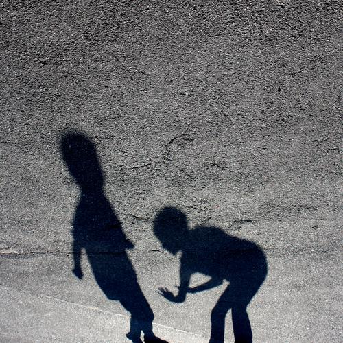 TU MIR NIX ! Subdued colour Exterior shot Shadow Silhouette Martial arts Parenting Schoolyard 2 Human being Crouch Fight Playing Stand Argument Aggression