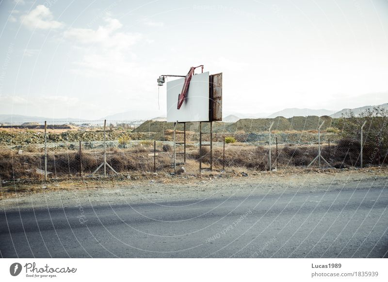 Advertising board old Environment Nature Landscape Sky Clouds Hill Cyprus Blackboard Billboard Signs and labeling Arrow Road traffic Street Fence Old Broken