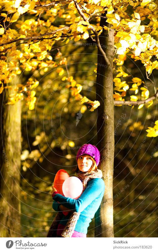 Human being Youth (Young adults) Tree Forest Adults Yellow Young woman Autumn Feminine Freedom Sadness 18 - 30 years Moody Smiling Balloon Kitsch