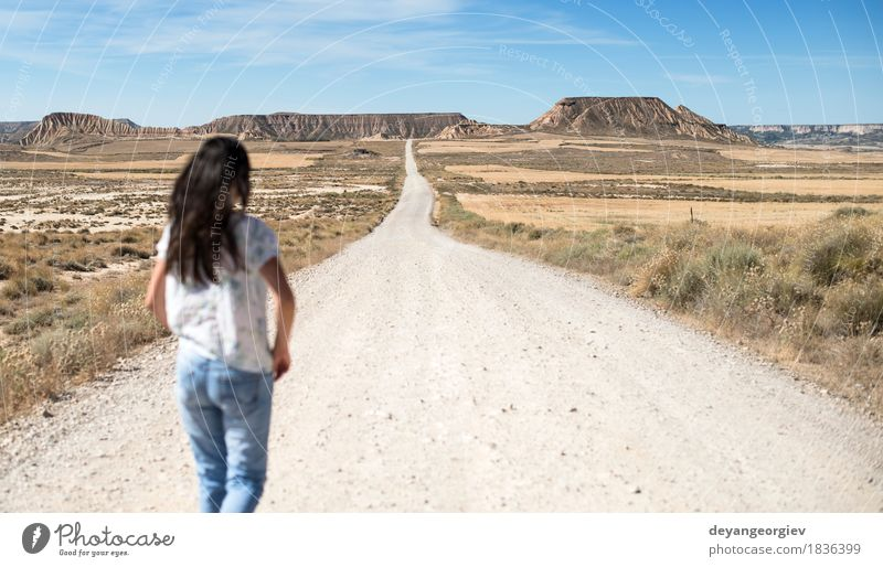 Woman with jeans walking on wild west Sky Vacation & Travel Sun Eroticism Loneliness Girl Far-off places Mountain Adults Street Lanes & trails Freedom Going