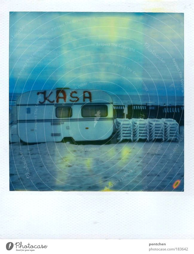 Caravan with the inscription kasa Kasse is located on the beach. Rental. Beach chairs. Beach chairs Colour photo Subdued colour Exterior shot Polaroid