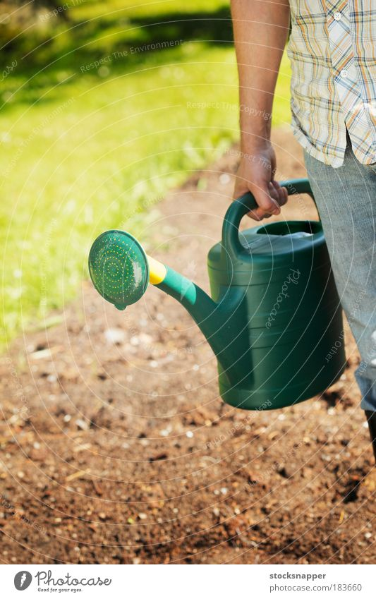 Watering can hand green a royalty free stock photo from for Big hands for gardening