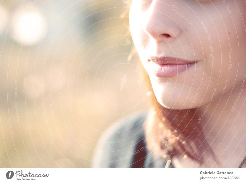 lip stories Colour photo Exterior shot Copy Space left Light Shadow Blur Feminine Hair and hairstyles Nose Mouth Lips Brunette Breathe To enjoy Smiling Free