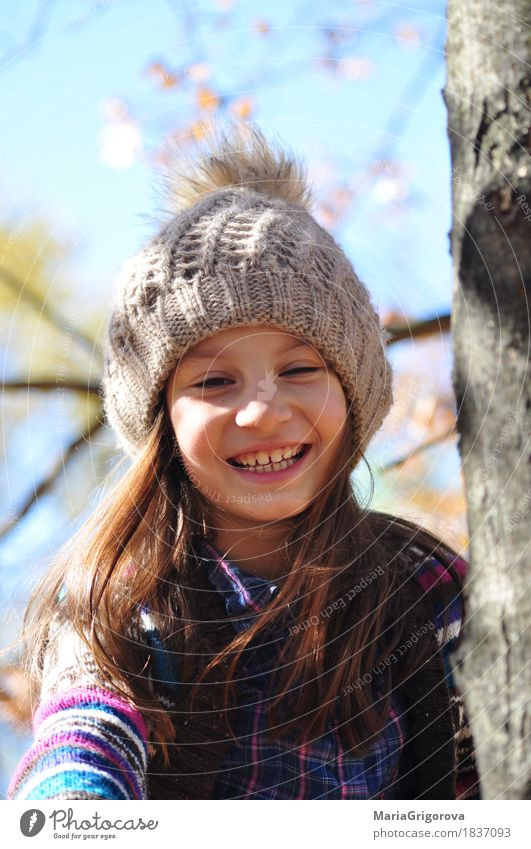 Beautiful smiling girl on the autumn tree Human being Child Sky Nature Sun Tree Leaf Joy Girl Forest Face Eyes Autumn Garden Park