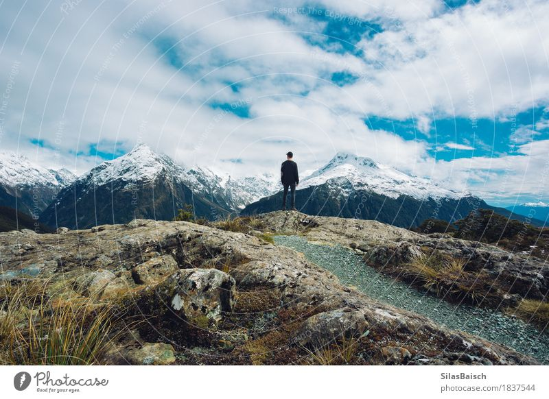 Majestic Mountains Nature Vacation & Travel Youth (Young adults) Young man Landscape Clouds Joy Far-off places Winter Mountain Happy Freedom Moody Rock Trip Hiking