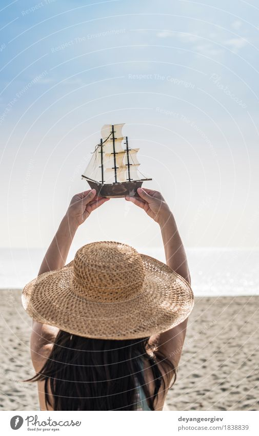 Woman with hat hold boat model Joy Happy Beautiful Vacation & Travel Tourism Summer Beach Ocean Decoration Girl Adults Hand Nature Yacht Sailboat Watercraft Hat