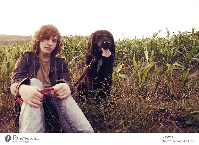 Human being Nature Youth (Young adults) Summer Man Animal Environment Portrait photograph Dog Emotions Friendship Field Together Sit Trip