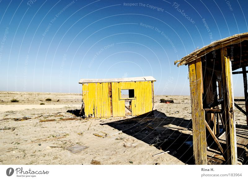 forsake sb./sth. Environment Nature Landscape Earth Sand Cloudless sky Warmth Desert Hut Old Blue Yellow Solidarity Appetite Thirst Loneliness Poverty
