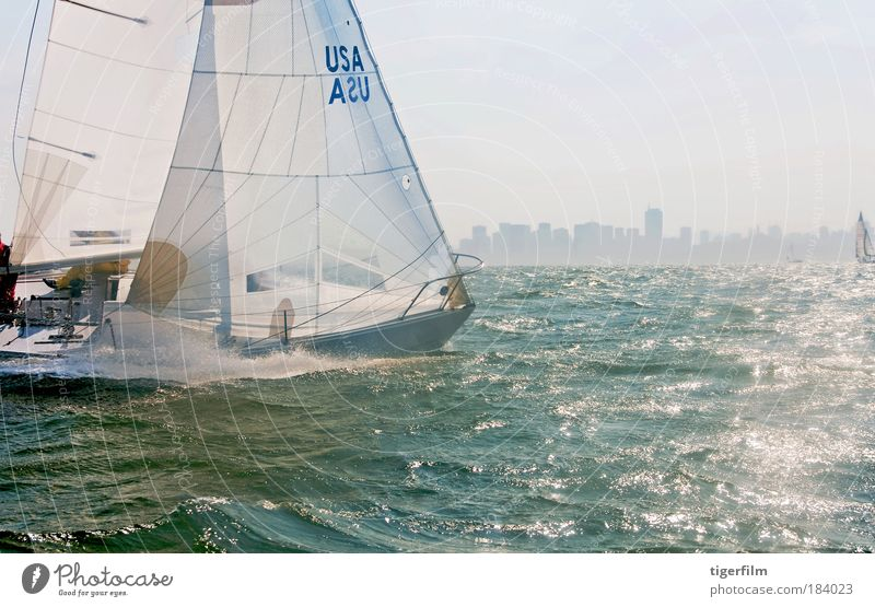 a sailboat racing on the bay Nature Water Summer Sports Landscape Watercraft Waves Horizon Leisure and hobbies Glittering High-rise Skyline Racing sports Beautiful weather Bay Sailing