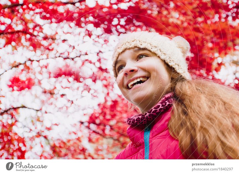 Low angle shot of happy girl under red blurred autumn tree Happy Beautiful Garden Girl Nature Autumn Tree Leaf Park Hat Hair Smiling Happiness Bright Red Colour