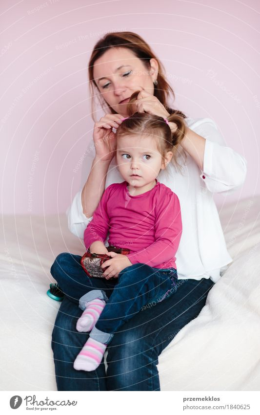Mother doing her little daughter's hair Beautiful Hair and hairstyles Child Baby Toddler Girl Woman Adults Parents Family & Relations Infancy 1 - 3 years