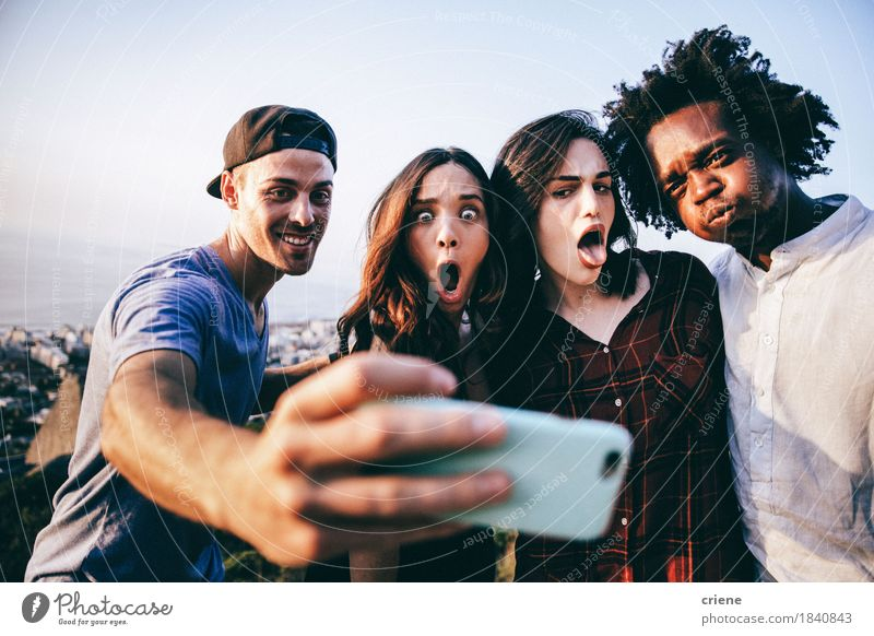 Group of mixed race adults taking selfie with smart phone Human being Youth (Young adults) Young woman Young man Joy Funny Lifestyle Freedom Group Couple Together Friendship Leisure and hobbies Technology Happiness Smiling