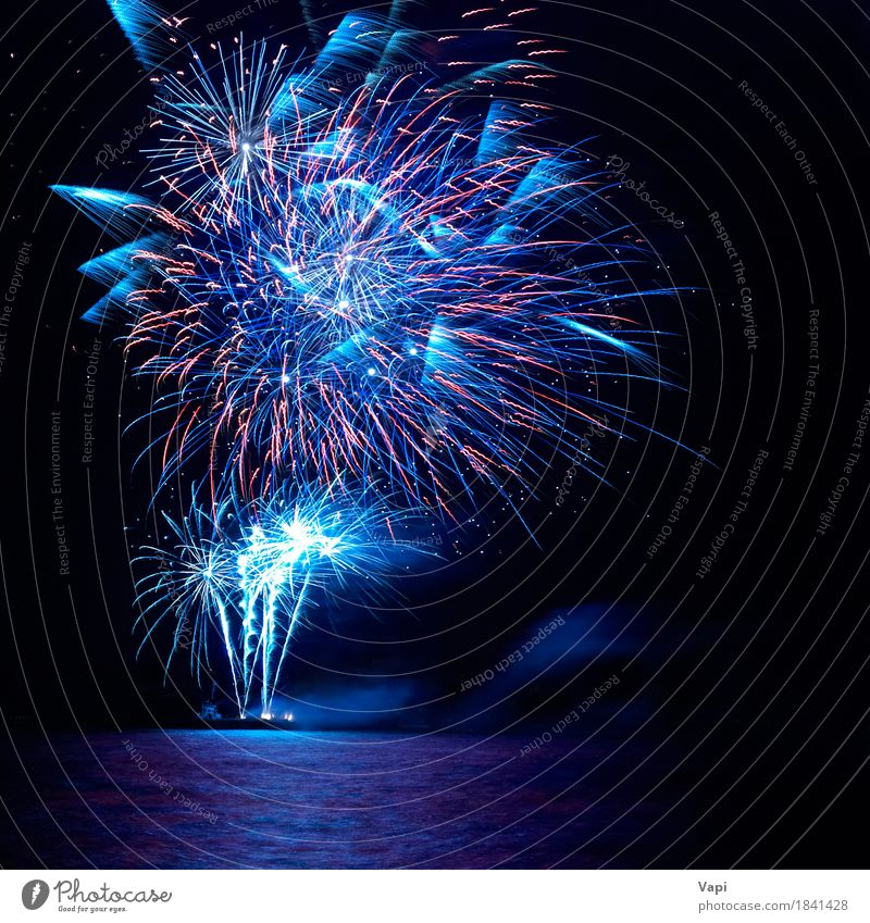 Blue and red colorful holiday fireworks Sky Christmas & Advent Colour Water White Red Joy Dark Black Yellow Feasts & Celebrations Party Lake Bright New