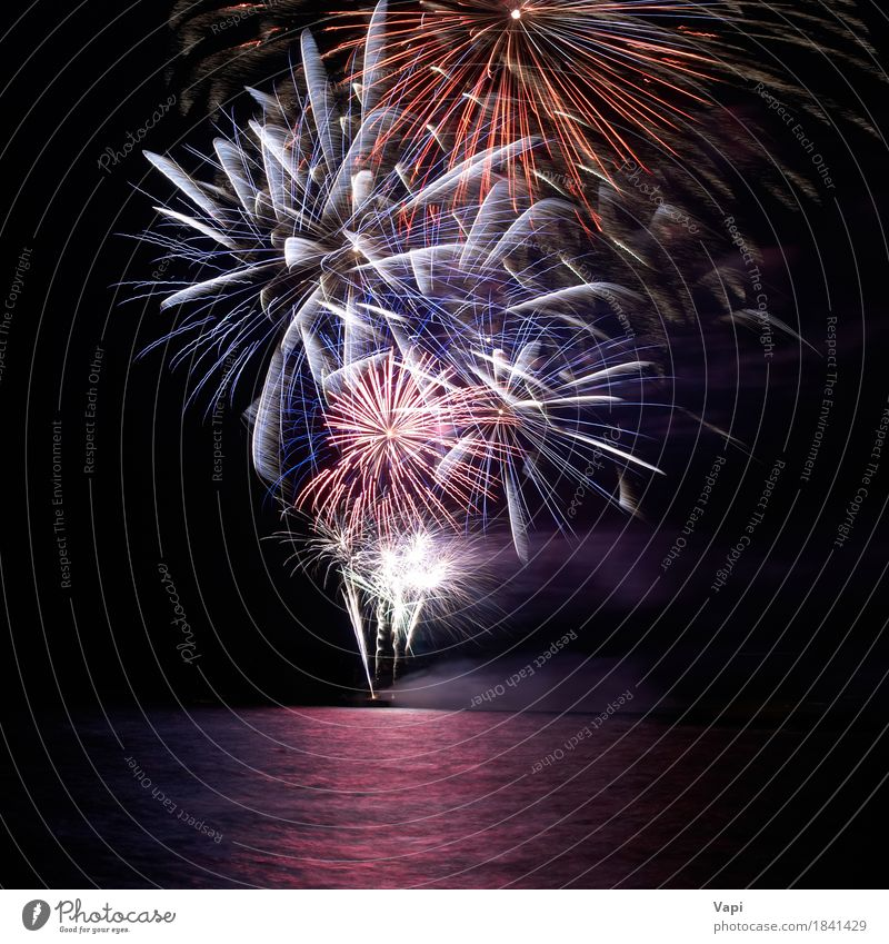 Blue and red colorful holiday fireworks Joy Night life Entertainment Party Event Feasts & Celebrations Christmas & Advent New Year's Eve Water Sky Night sky