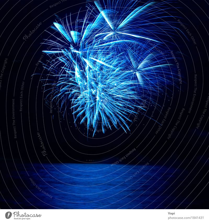 Blue colorful holiday fireworks Sky Christmas & Advent Colour Water White Joy Dark Black Feasts & Celebrations Party Bright New Event New Year's Eve Turquoise