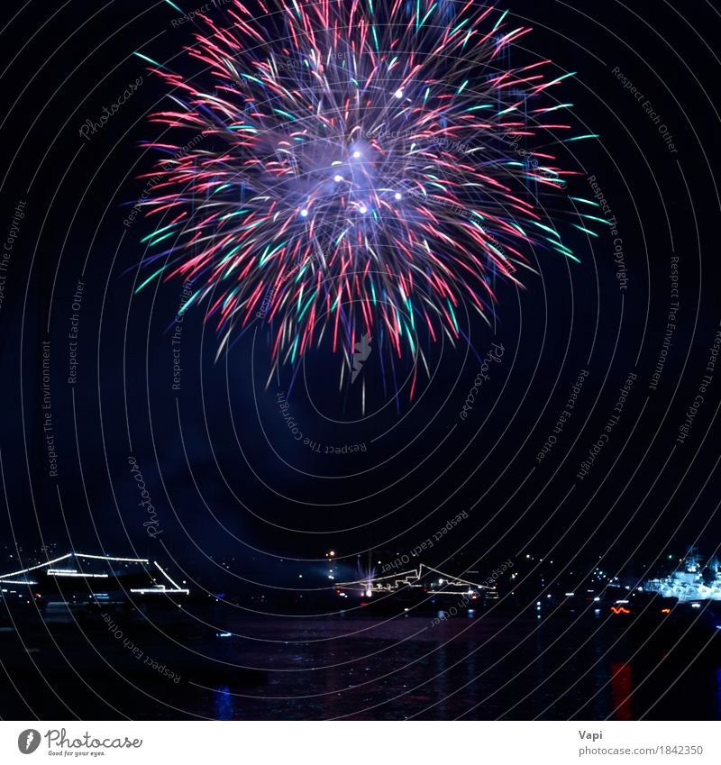 Colorful fireworks Joy Freedom Night life Party Event Feasts & Celebrations Christmas & Advent New Year's Eve Art Sky Night sky Lake Dark Bright Blue Yellow