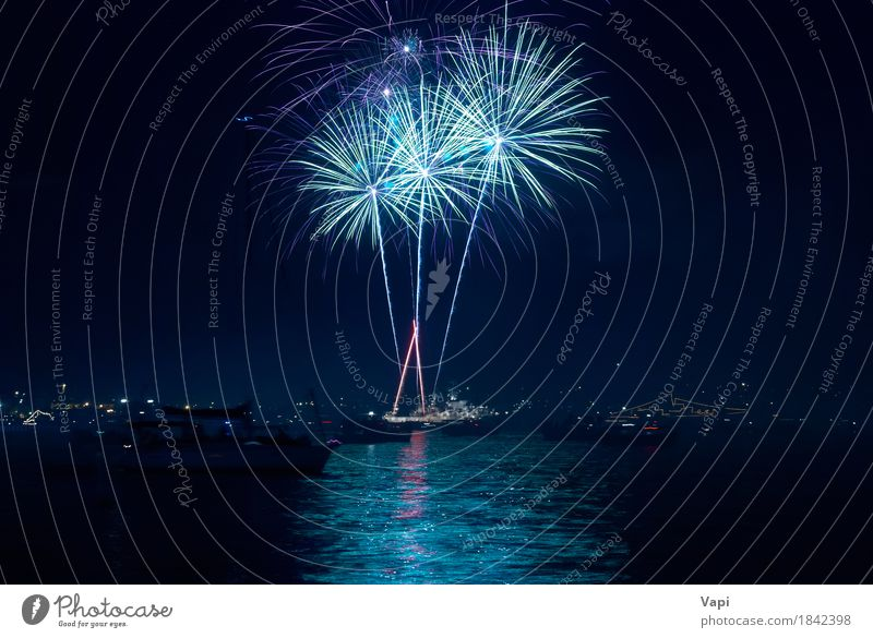 Colorful fireworks above a lake Sky Blue Christmas & Advent Colour City Green Water White Red Joy Dark Black Yellow Art Freedom Feasts & Celebrations