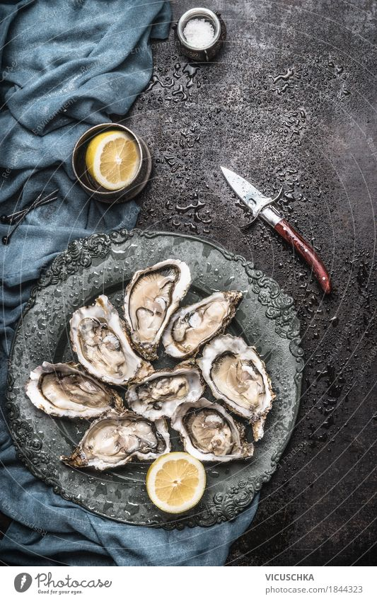 Oysters with lemon and oyster knife Food Seafood Nutrition Lunch Dinner Buffet Brunch Banquet Crockery Plate Knives Style Design Healthy Eating Life Table