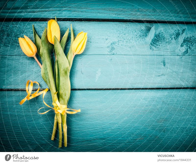 Yellow tulips bouquet on turquoise background Style Design Decoration Feasts & Celebrations Valentine's Day Mother's Day Birthday Nature Plant Flower Tulip Leaf