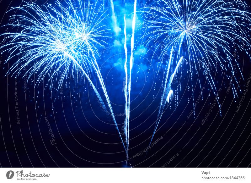 Blue colorful fireworks Joy Night life Entertainment Party Event Feasts & Celebrations Christmas & Advent New Year's Eve Art Sky Night sky Dark Bright Black
