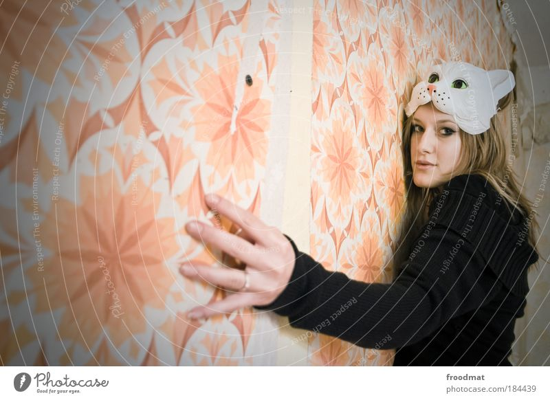 papergirl Colour photo Subdued colour Interior shot Day Light Wide angle Upper body Front view Looking into the camera Wallpaper Human being Feminine Mask