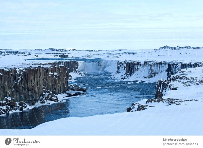 Wide shot of waterfall Selfoss in Iceland Vacation & Travel Tourism Adventure Far-off places Sightseeing Winter Waterfall basalt stones wintertime cold snow