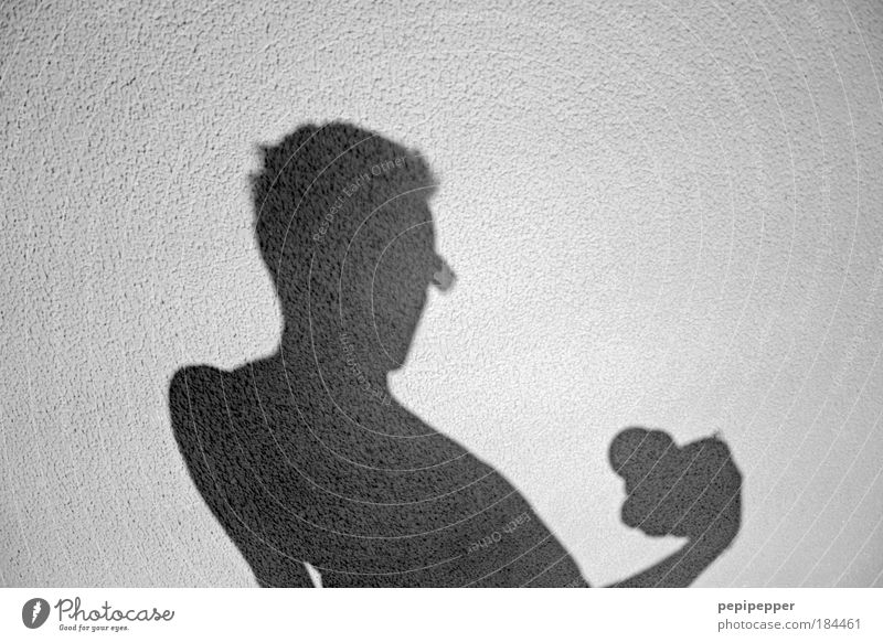 sunlight-shadow I Black & white photo Exterior shot Neutral Background Shadow Contrast Silhouette Sunlight Central perspective Portrait photograph Upper body