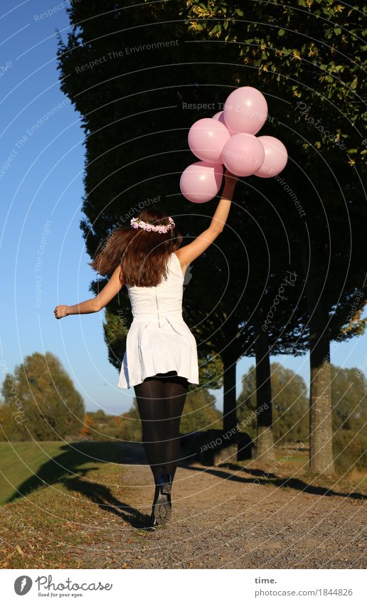 . Feminine Woman Adults 1 Human being Tree Park Lanes & trails Dress Tights Jewellery Hair circlet Balloon Movement To hold on Walking Jump Joy