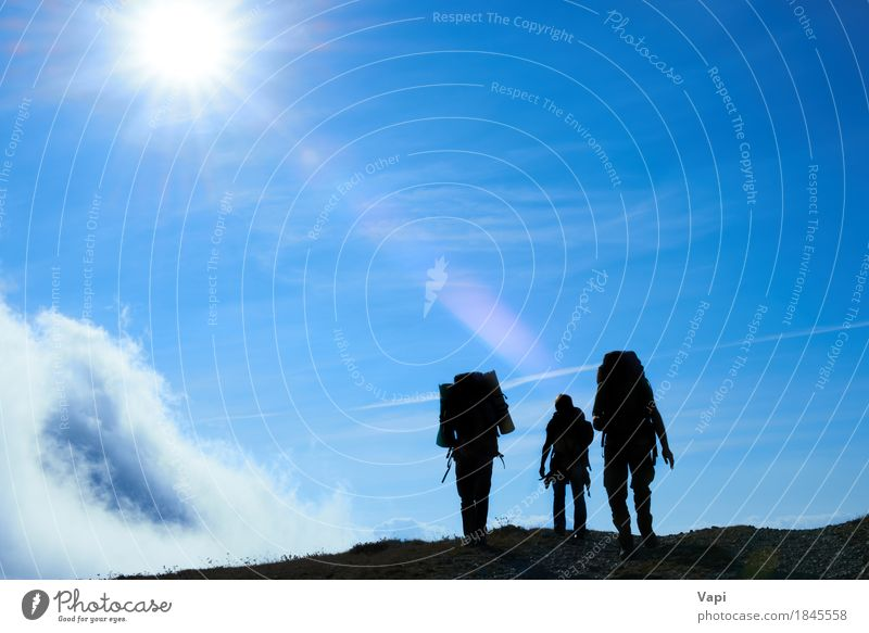 Silhouette of hiking friends against sun Human being Woman Sky Nature Vacation & Travel Youth (Young adults) Man Heaven Blue Summer White Sun Young man