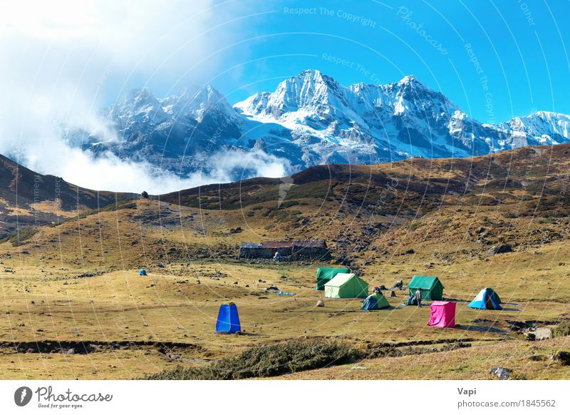 Campsite with tents on the top of high mountains Sky Nature Vacation & Travel Blue Summer White Landscape Clouds Winter Mountain Environment Yellow Grass Snow