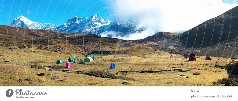 Campsite with tents on the top of high mountains. Panorama Sky Nature Vacation & Travel Blue White Sun Landscape Red Clouds Winter Mountain Environment Yellow Meadow Grass Snow