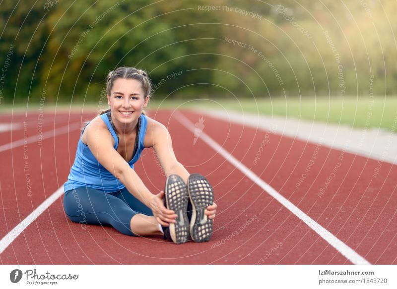 Fit young woman doing stretching exercises Human being Woman Youth (Young adults) Summer Beautiful 18 - 30 years Face Adults Lifestyle Sports Happy Copy Space Blonde Action Smiling Fitness