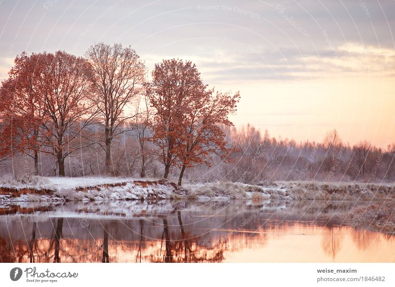 Cloudy autumn dawn. First snow on the autumn river Sky Nature Vacation & Travel Plant White Tree Landscape Clouds Far-off places Winter Forest Environment Yellow Autumn Natural Snow