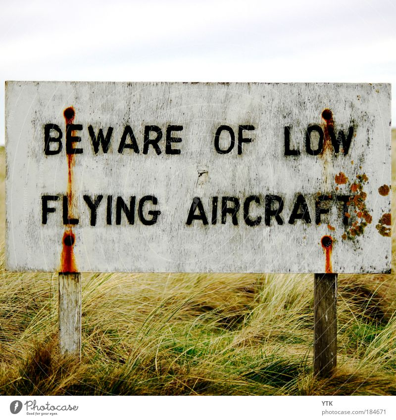 Old White Vacation & Travel Black Grass Funny Flying Signs and labeling Exceptional Transport Dangerous Aviation Signage Safety Threat Whimsical