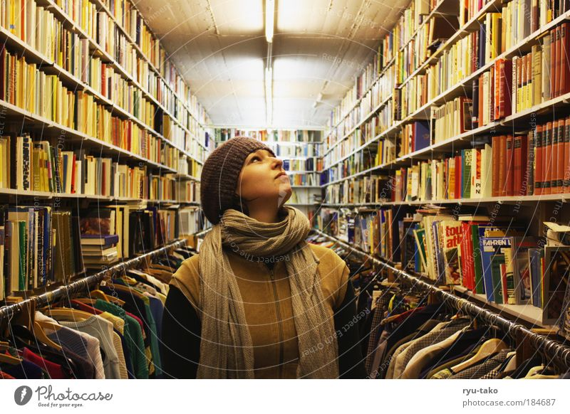 Between the knowledge Feminine Young woman Youth (Young adults) Head Face Scarf Hair and hairstyles Brunette Serene Inspiration Curiosity Perspective Calm