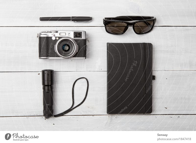 Set of cool travel stuff on wood Vacation & Travel Summer White Black Life Lifestyle Wood Tourism Trip Modern Retro Photography Things Camera Sunglasses Pen