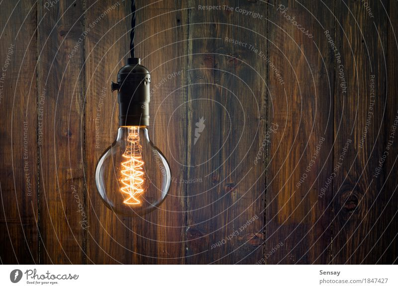 Vintage Incandescent Edison Type Bulb On Wooden Wall A