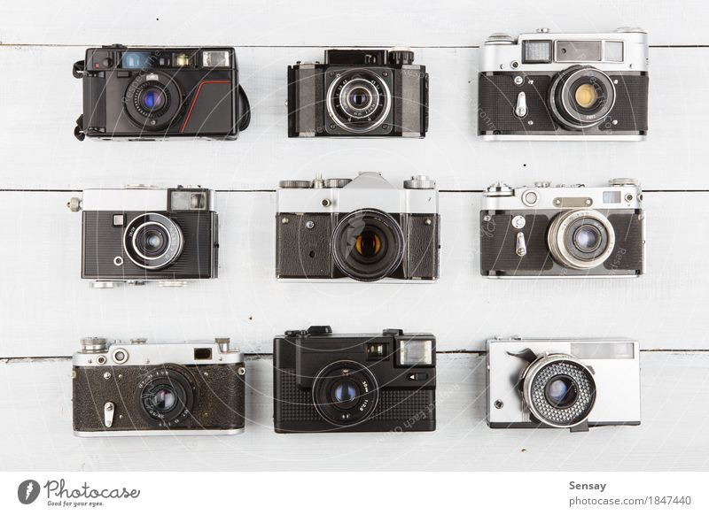 Set of vintage film cameras on wooden background Style Table Camera Art Wood Old Retro Black White Creativity Photography equipment Lens Antique space