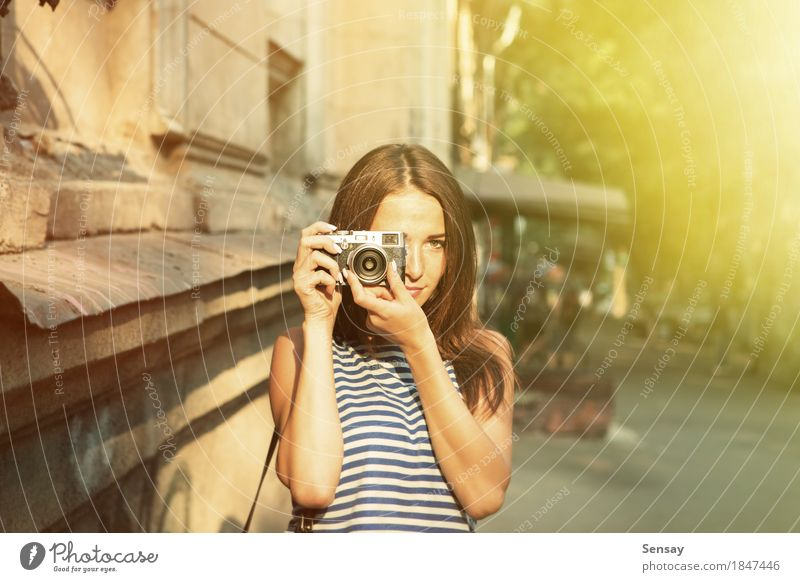 Pretty girl taking photo on the street Human being Woman Vacation & Travel Summer Beautiful White Sun Hand Joy Girl Face Adults Street Autumn Happy Fashion