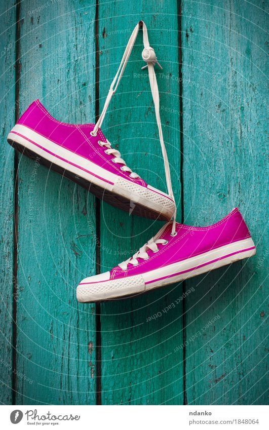 pair of bright pink sneakers hanging on a cord Woman Youth (Young adults) Man Old Colour Girl Adults Sports Style Wood Fashion Couple Feet Design Pink Earth