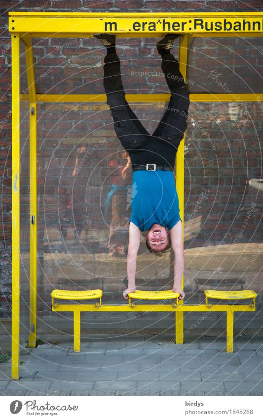 Young man doing a handstand in a bus shelter Athletic Fitness Sports Training Masculine Youth (Young adults) 1 Human being 18 - 30 years Adults Shelter Bus stop